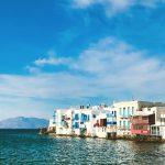 white houses on the coastline in Mykonos