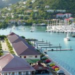 harbour in the BVI with buildings and boats on a British Virgin Islands catamaran charter