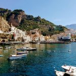 Amalfi coast with boats and mountains on a Europe yacht charter with skipper