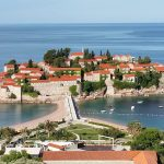 island with orange roofed houses and ocean in Montenegro on a europe bareboat charter