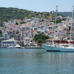 colourful houses and sailing boats in greece on a greek islands yacht charter with skipper