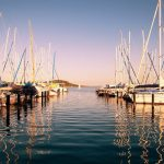 sailing boats in a marina at sunset