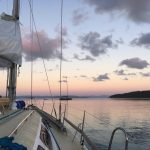 sailing boat in the Whitsundays at sunset