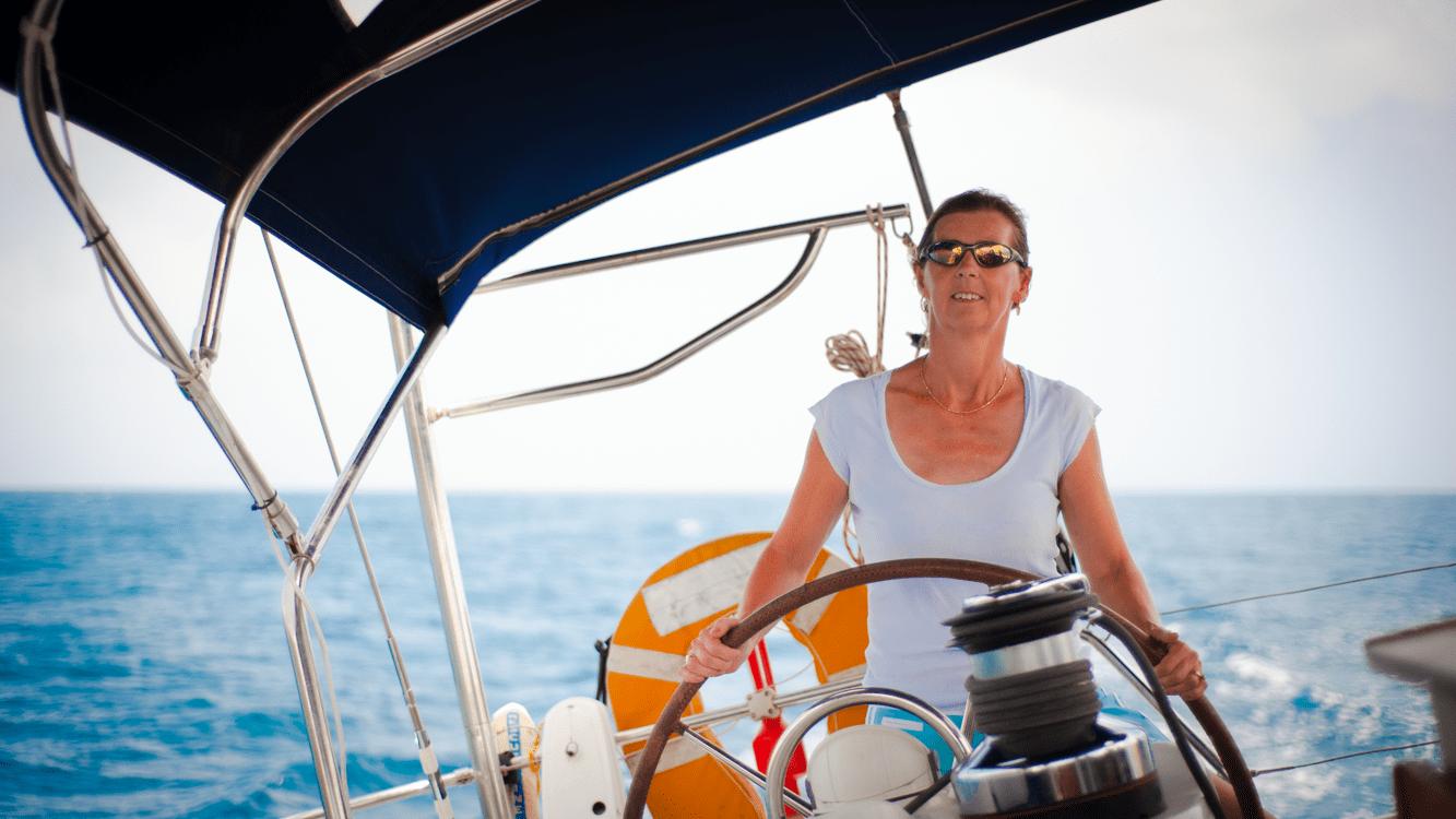 A female skipper in control on a skippered charter