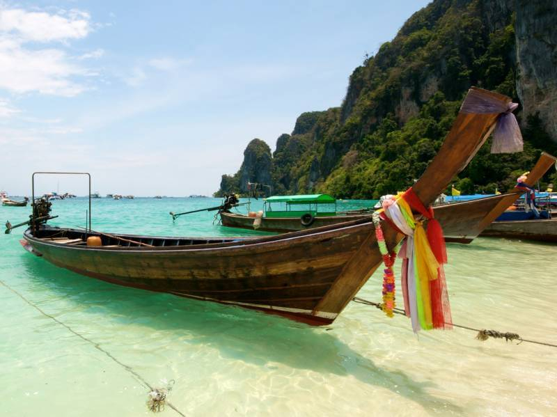 A picture of a long tail on a beach in Thailand