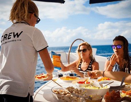 hostess serviing drinks on a yacht charter