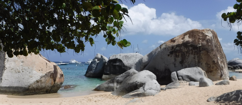 rocks and clear water on a bvi sailing itinerary
