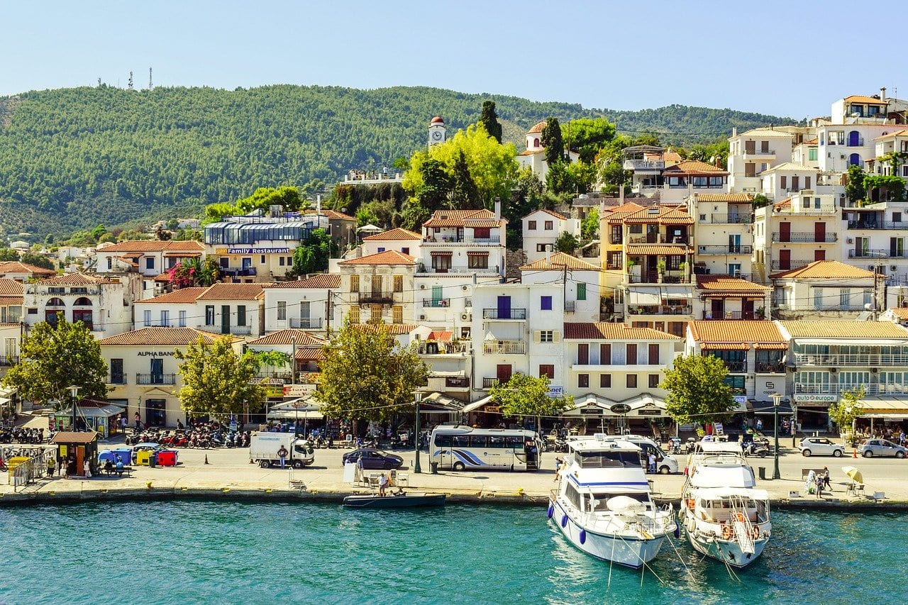 colourful. houses and boats moored in the Sporades