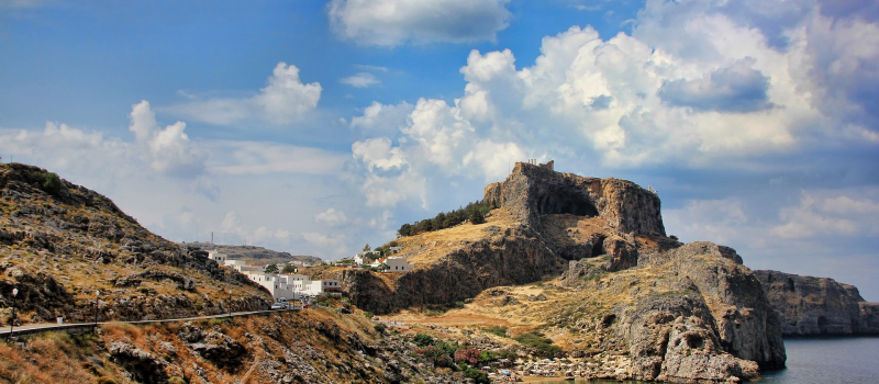 mountains and white houses on a Dodecanese sailing itinerary