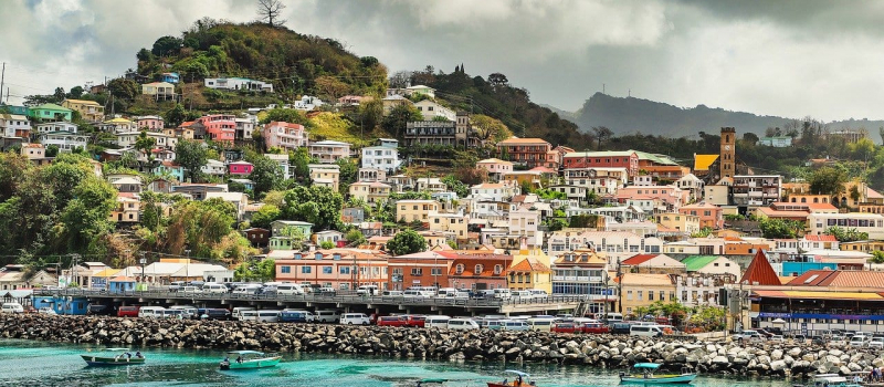 colorful houses and clear water on a Grenada sailing itinerary