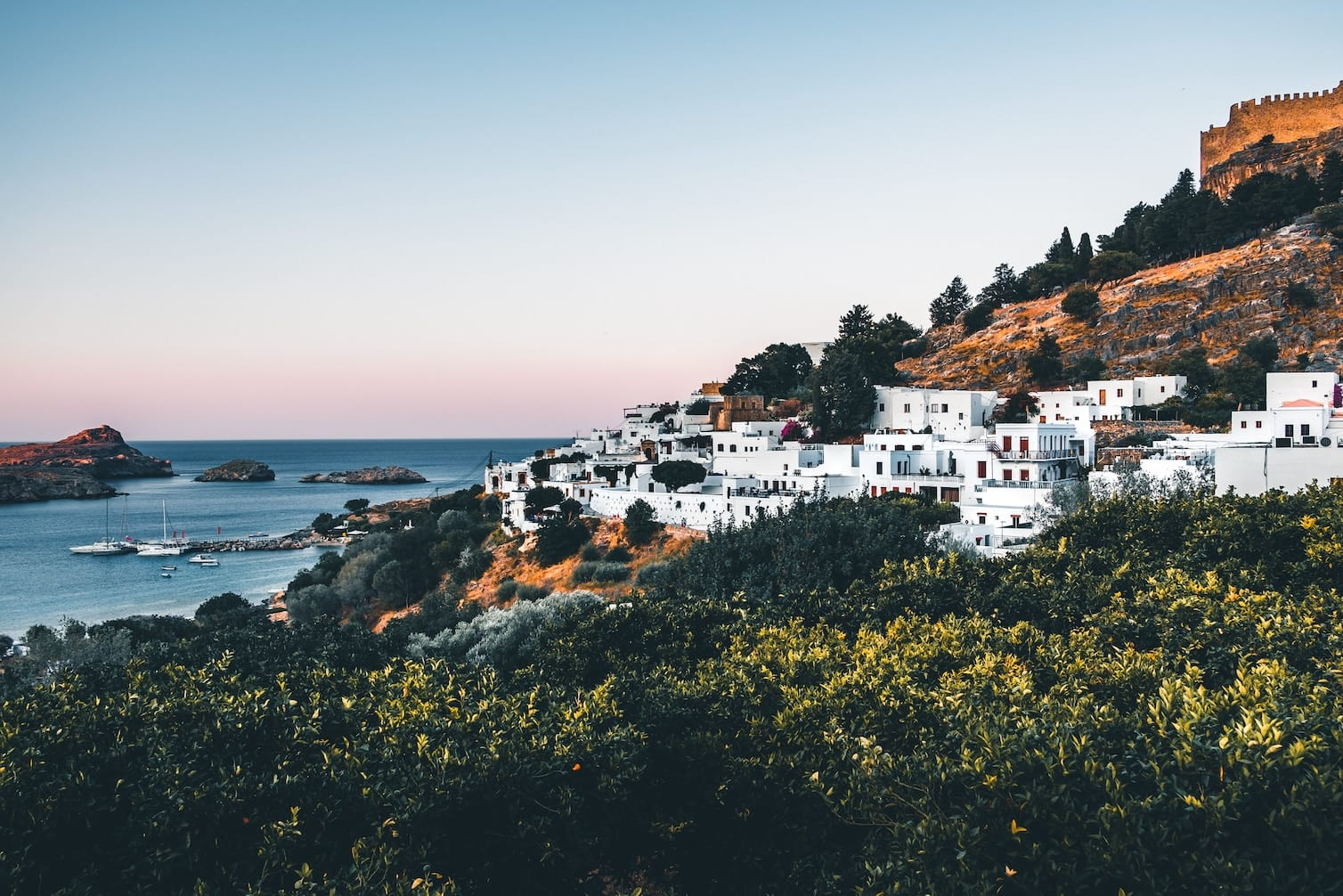 white houses in Rhodes next to the ocean