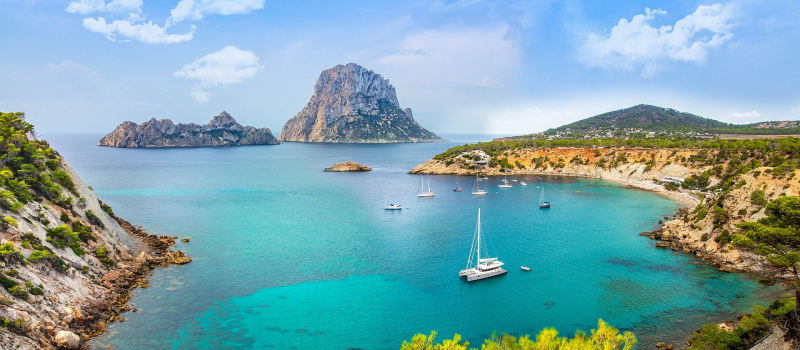 sailing boat and surrounding mountains on an ibiza sailing itinerary
