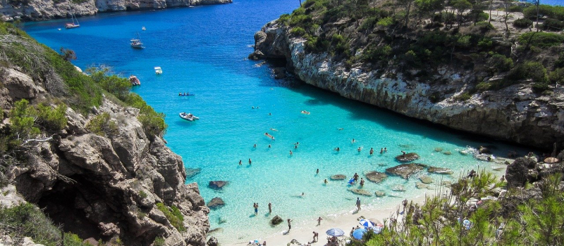 cove with clear water on an ibiza sailing itinerary