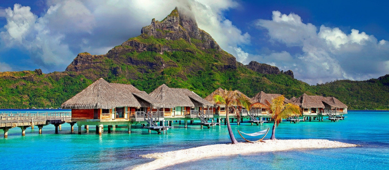 bungalows and clear water on a Tahiti sailing itinerary
